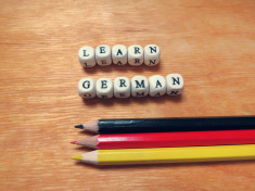 stock-photo-70546255-caption-beads-learn-german-and-colored-pencils